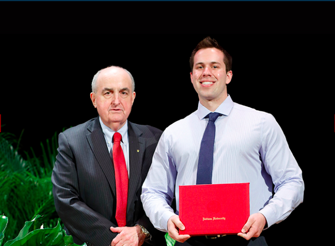 Accepting the 2017 Lieber Memorial Teaching Associate Award while standing beside Indiana University President Michael A. McRobbie.