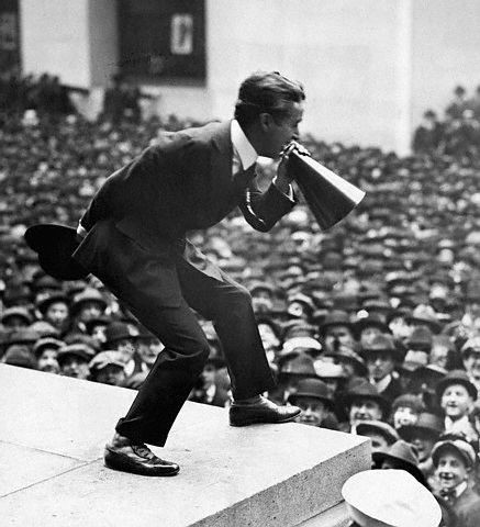 Chaplin riling up crowds for the war effort in a delightfully old-timey fashion.
