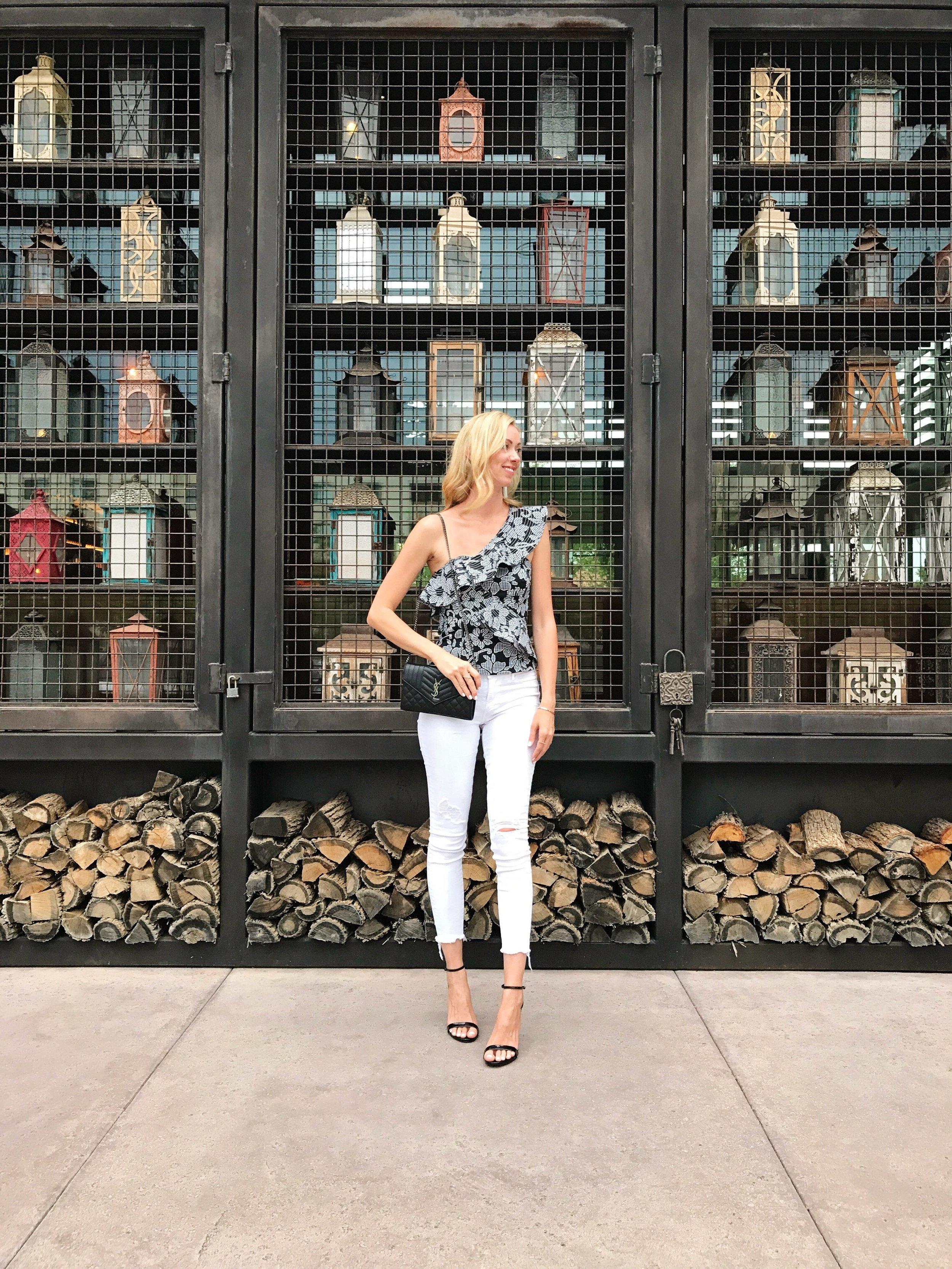 Zara-black-floral-one-shoulder-women's-top-white-jeans.jpg