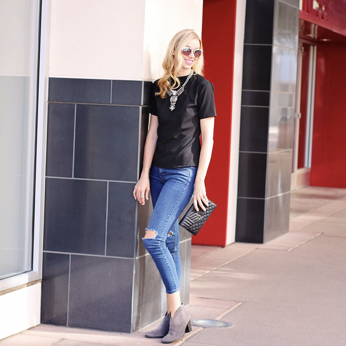 gray-booties-ripped-jeans-ysl-clutch.jpg