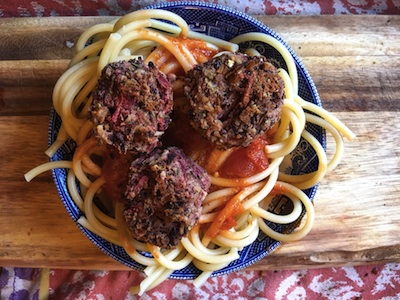 Beet balls over pasta