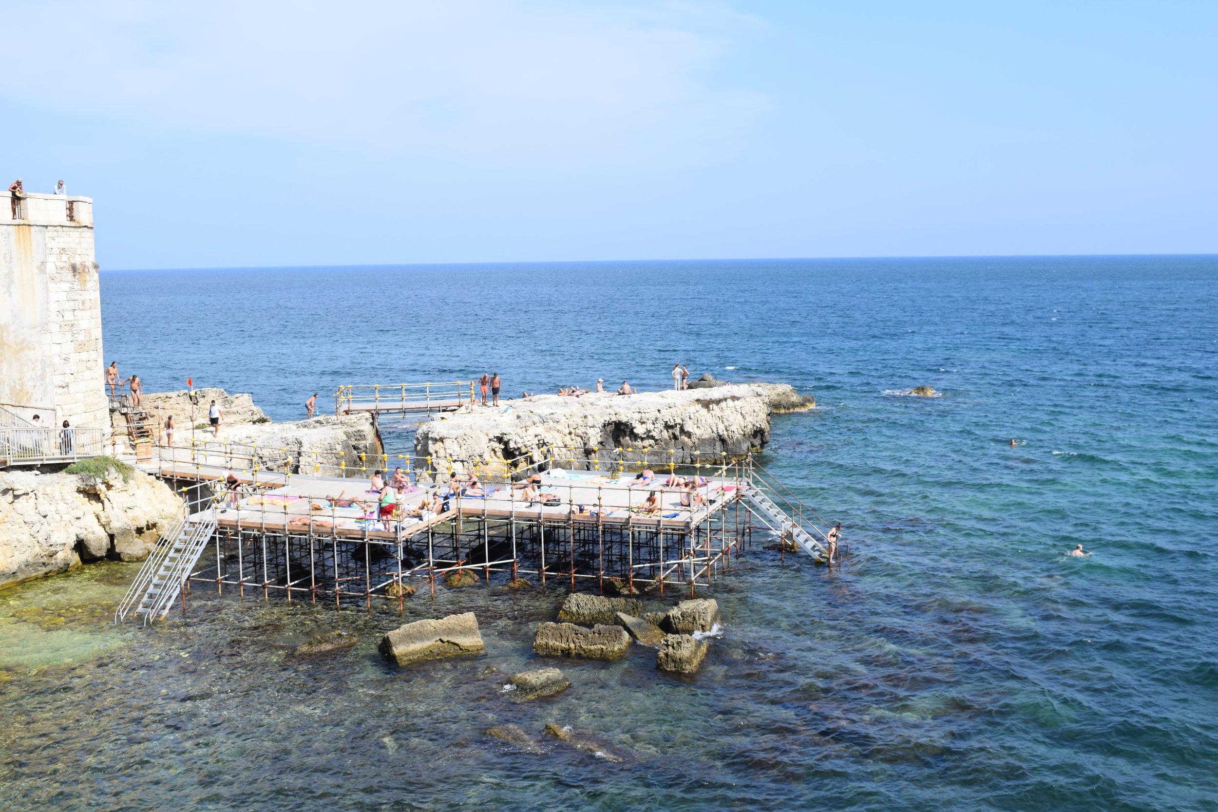 A platform that serves as a beach in Ortigia