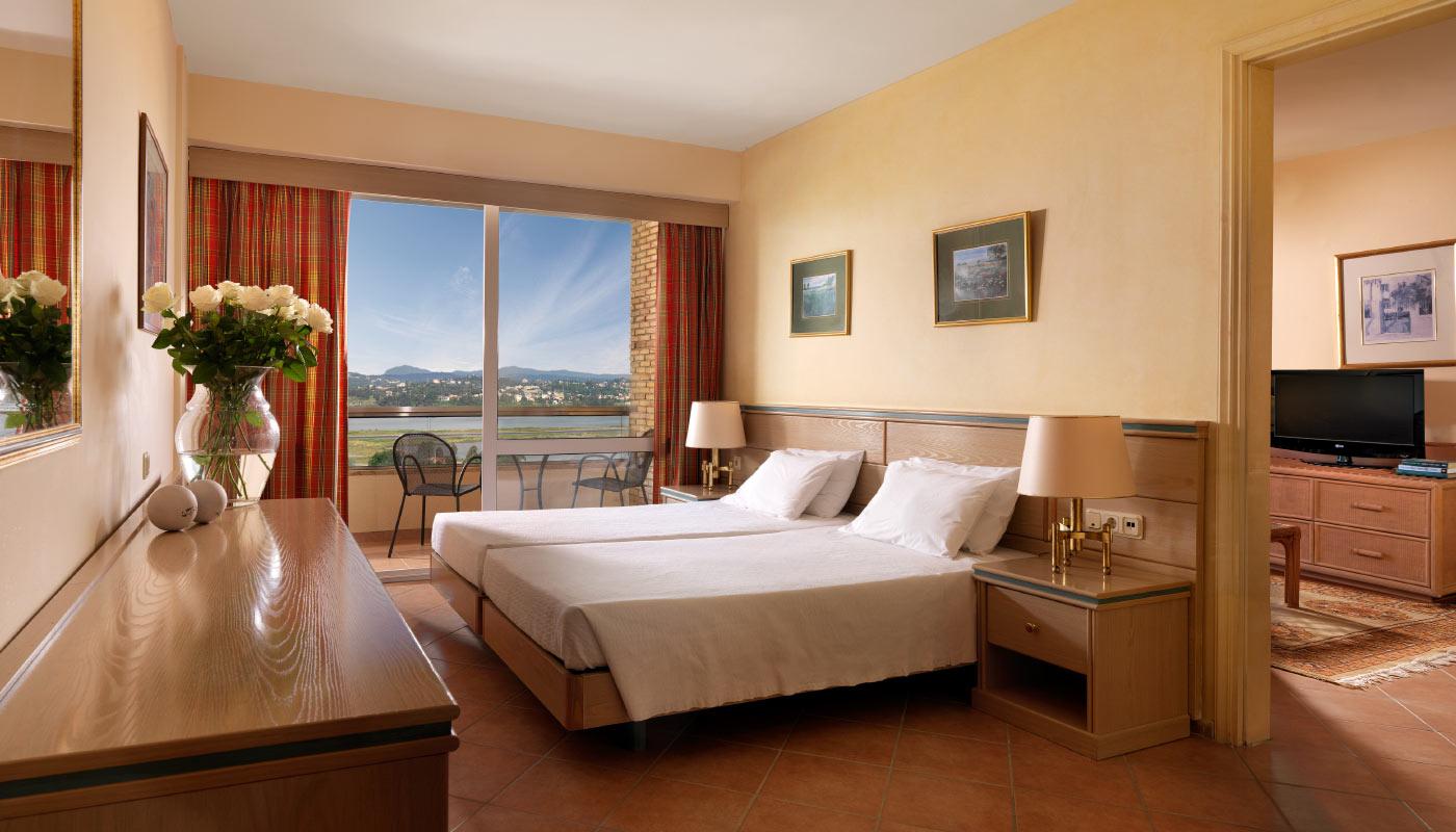divani-corfu-palace-junior-suite-bedroom.jpg