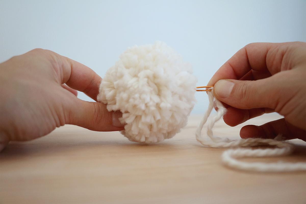 DIY Neutral Pom Pom + Wooden Bead Garland | root + dwell