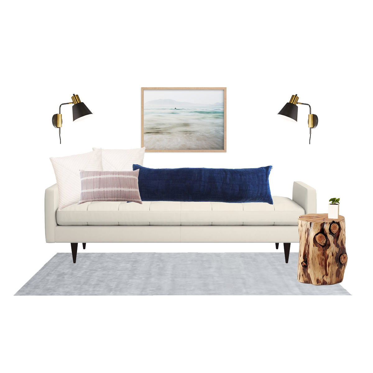 daybed  |  cream pillows  |  tie dye pillow  |  blue pillow  |  side table  |  plant  |  sconces  |  artwork  |  rug