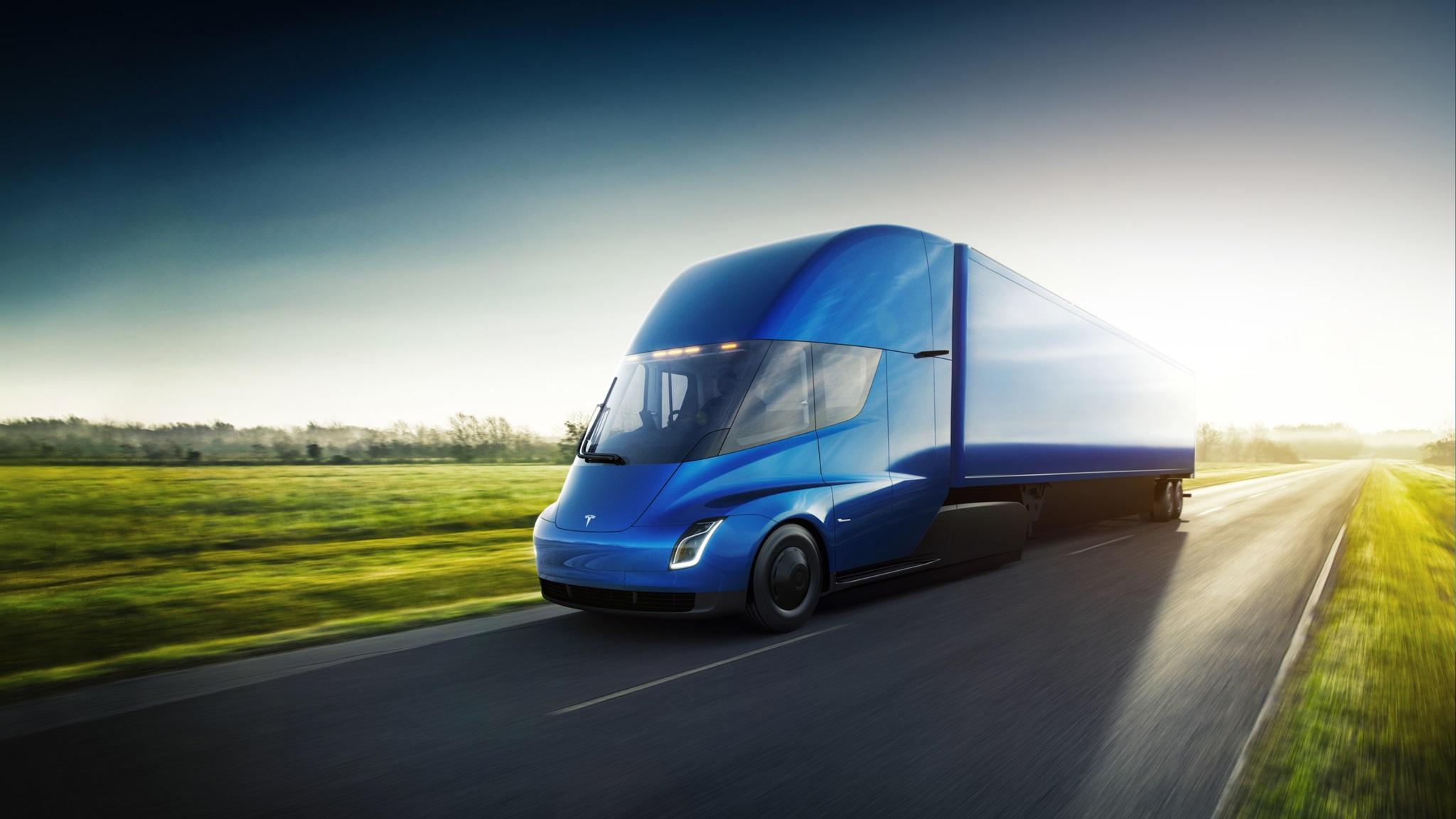 Tesla-Semi-exterior-blue-trailer-driving.jpg