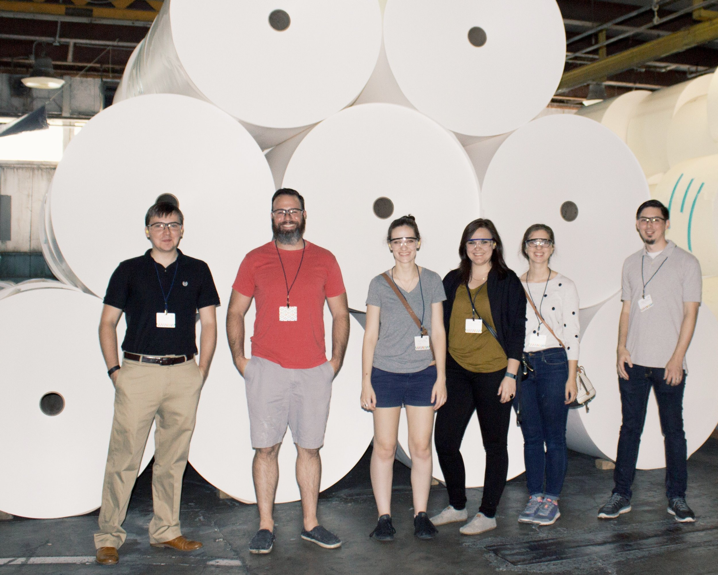 Our tour group in front of the huge rolls of the finest Mohawk paper. Photo taken by Ariel Smullen.