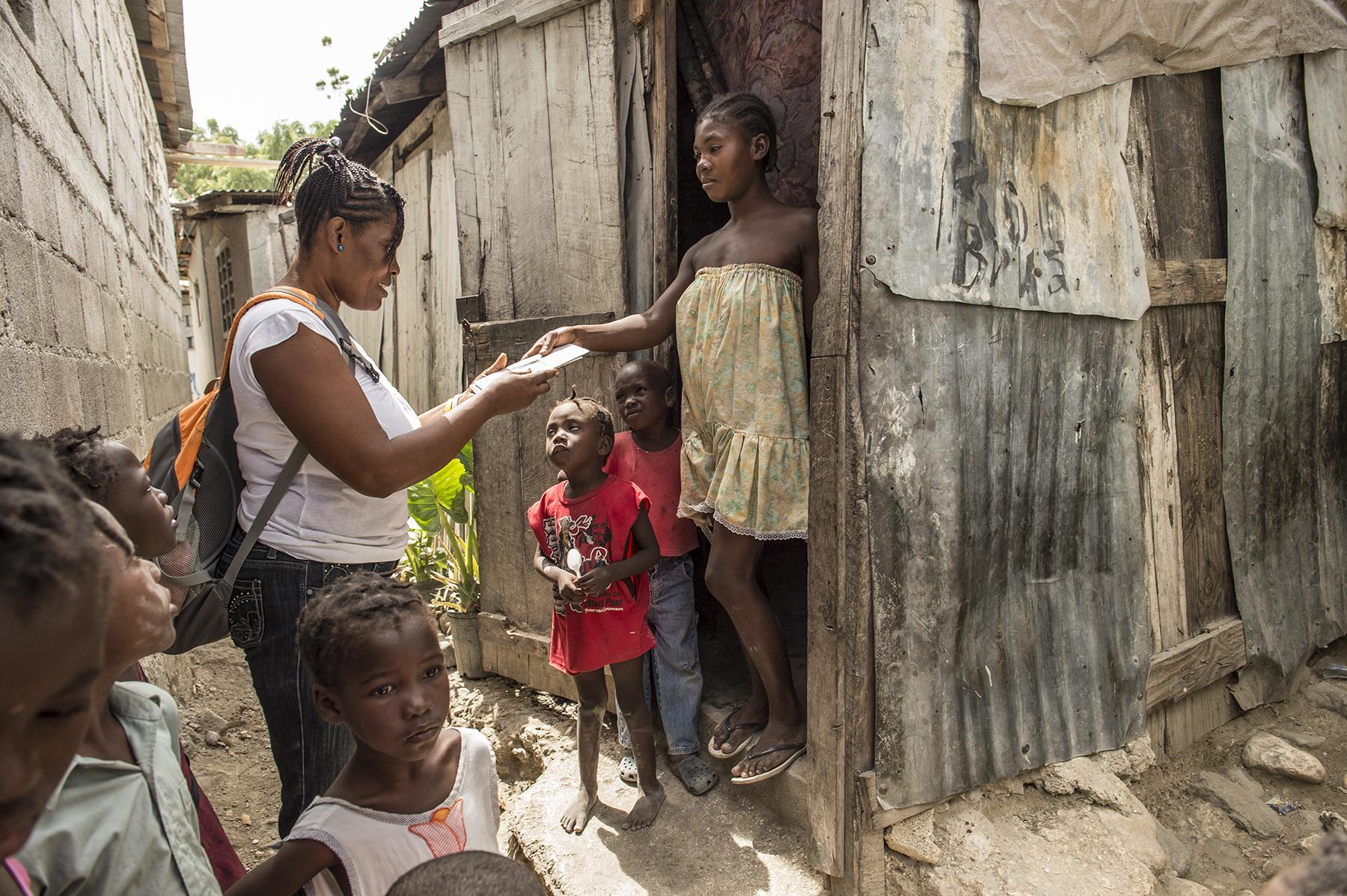Door-to-door outreach in Cite Soleil