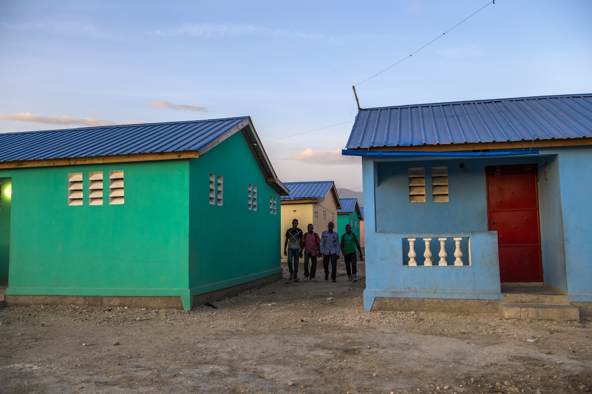 Members of our Haitian team stroll through houses built by the foundation in Port-au-Prince