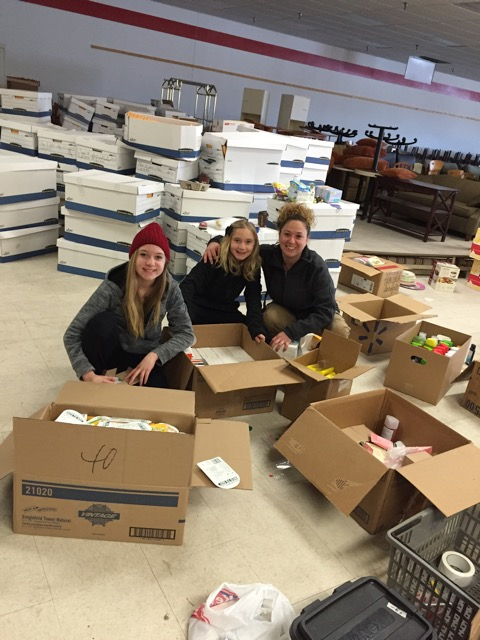 Students work at sorting donations at a holding warehouse in Pennsylvania