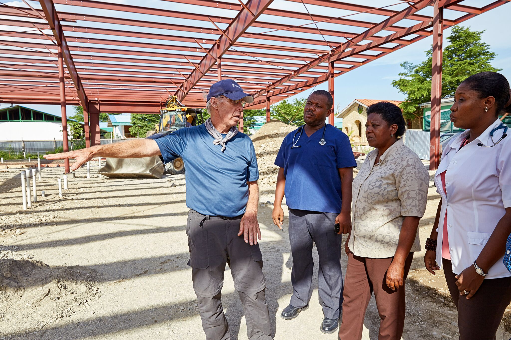 Advisory Board member Jim Corcoran consults with hospital staff on construction of the new medical facility