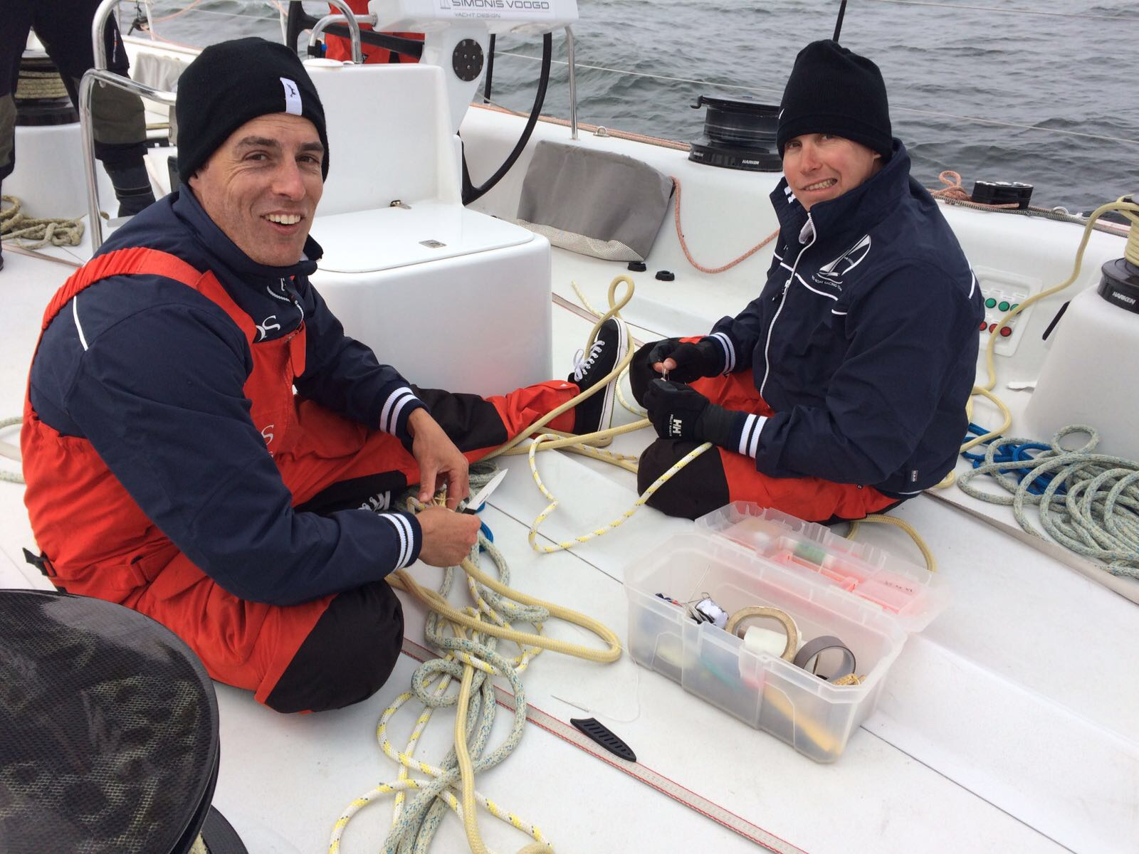 Malcolm and Jamie take advantage of the a long tack to do some whipping of the jib sheet rope covers.