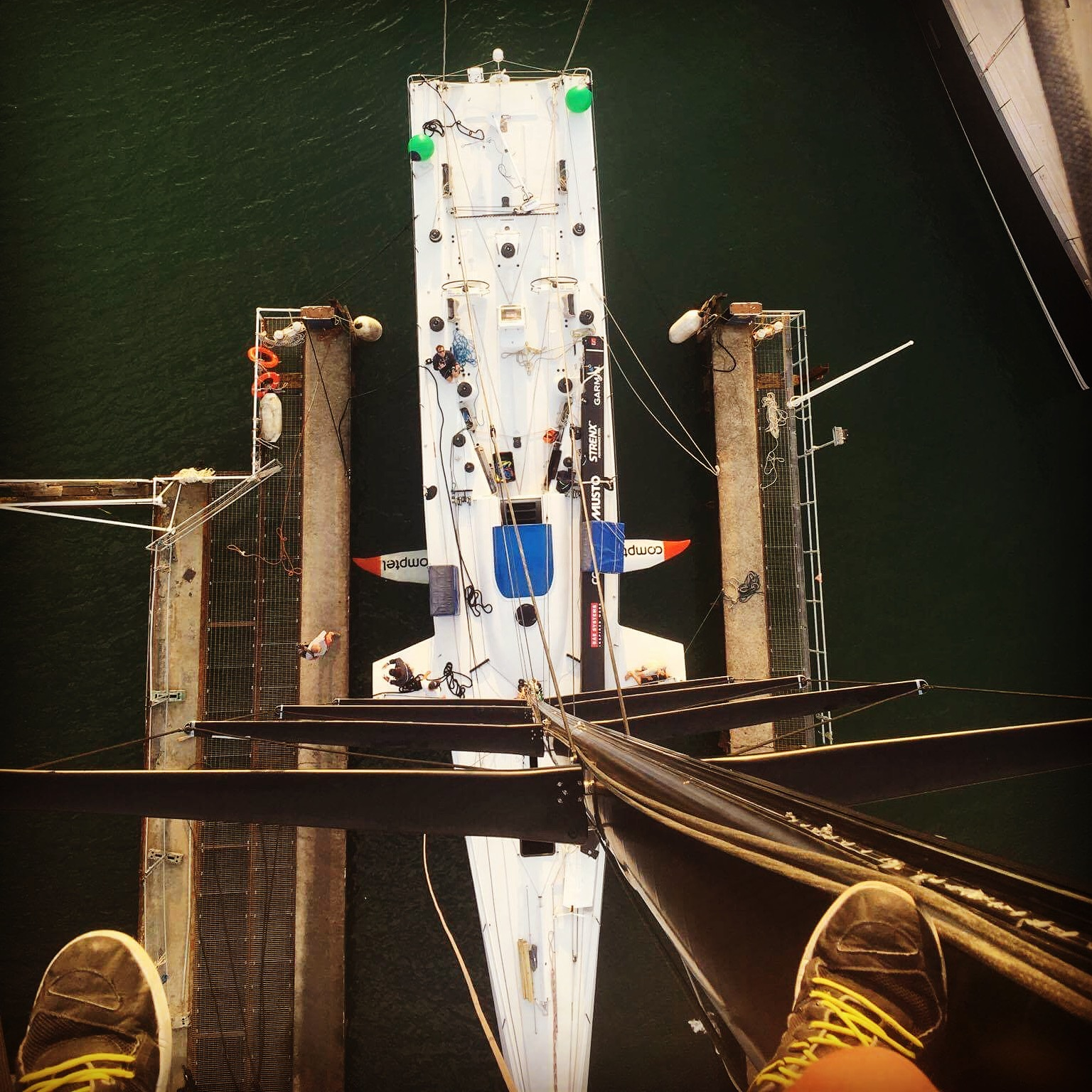 Up the mast with crew member Alan Turner