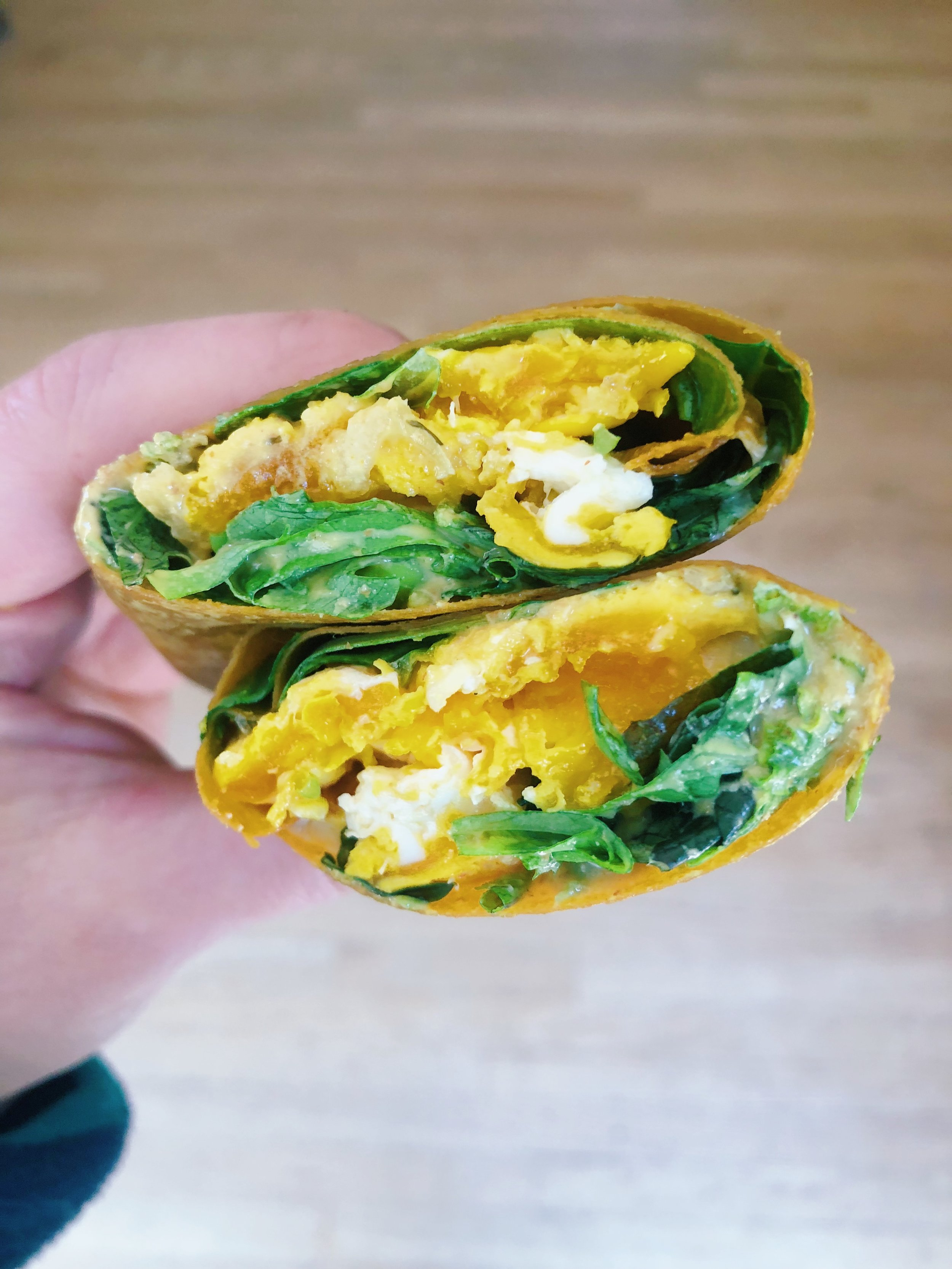 Here's the Curry Miso dressing on a turmeric coconut wrap with a fried pastured egg, avocado, tat soi and garlic dill kraut.