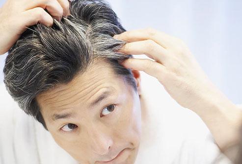 photolibrary_rf_photo_of_man_looking_at_gray_hair.jpg
