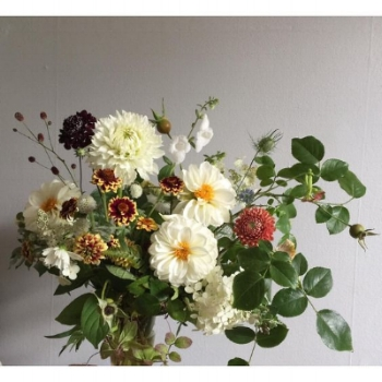 A mix of rose hips, aztec zinnias, hydrangea, dahlias and campanula