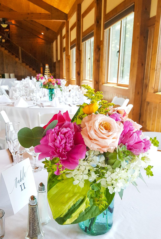 Aqua Mason Jar Centerpiece - vibrant peonies, roses and ranunculus