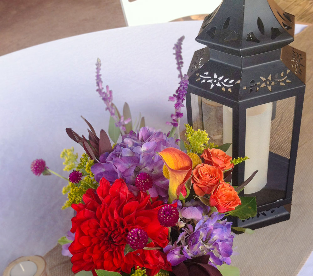 Lantern, Vibrant Fall Blossons and Burlap Centerpiece
