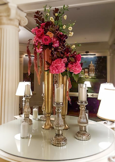 Rich gold metal vases with silver mercury glass candlesticks