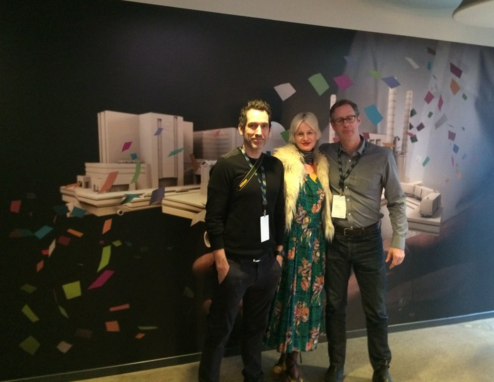 Kevin, Marion and Todd in front of one of the larger posters