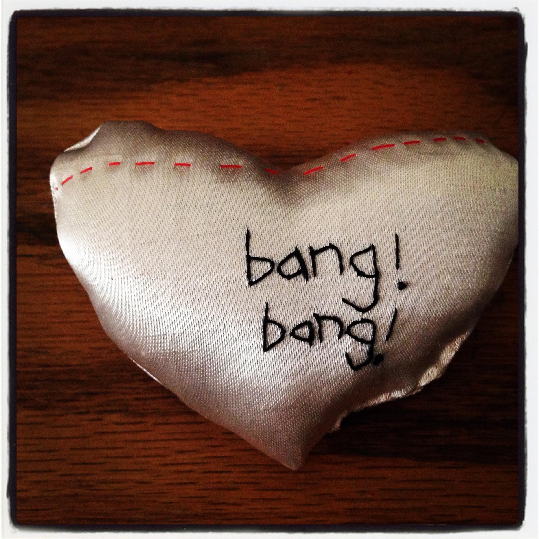 satin heart pillow,  bang, bang!