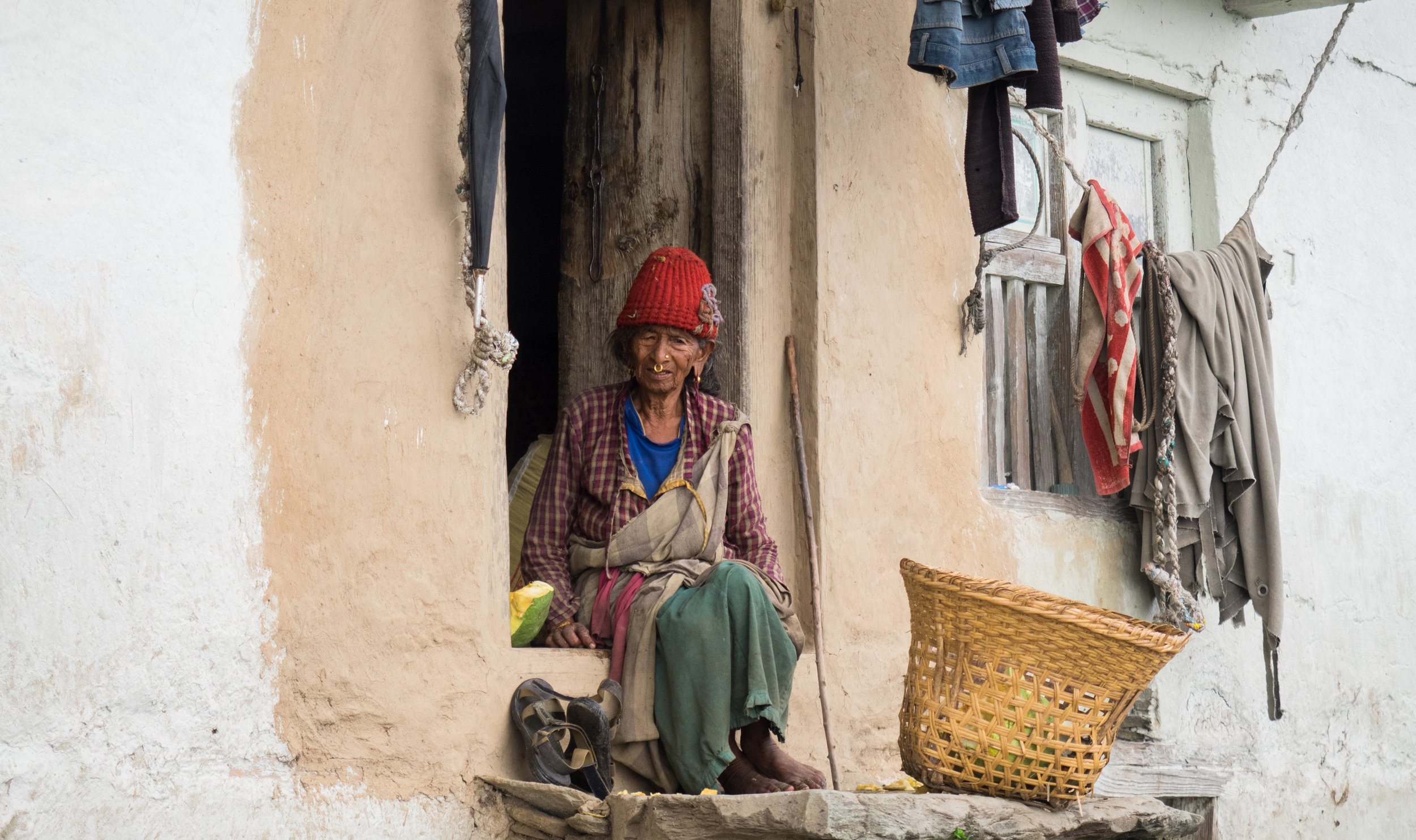 P8090234_Old woman in front of home in Bajhang - Aug 2017 - by Elina Tran.jpg