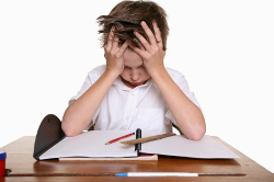 frustrated child writing