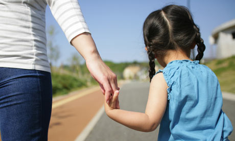 child walking with parent
