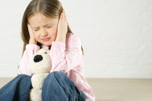 child upset by loud noise