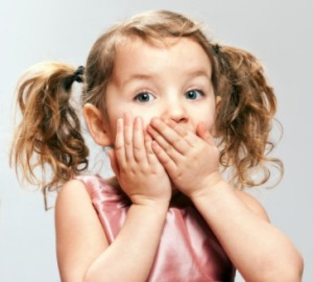 girl holding her mouth