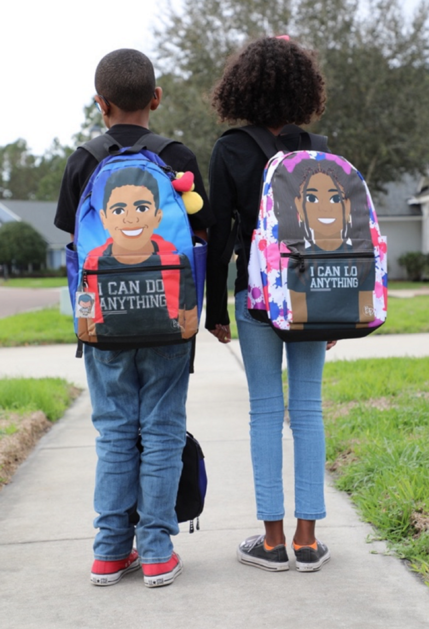 Carter Mitchell (age 9) and Ella Weaver (age 10) stop for a quick photo while walking home from school with their Blended Designs backpacks.