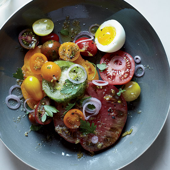 These Food & Wine Daily recipes look AMAZING!!!!    Healthy & Delicious:   This warm, garlicky anchovy dressing here is fantastic with an assortment of juicy, peak-season tomatoes. To finish the dish, Amelia O'Reilly and Nico Monday top it with tangy pickled shallots and an oozy, soft-boiled egg.     Recipe!