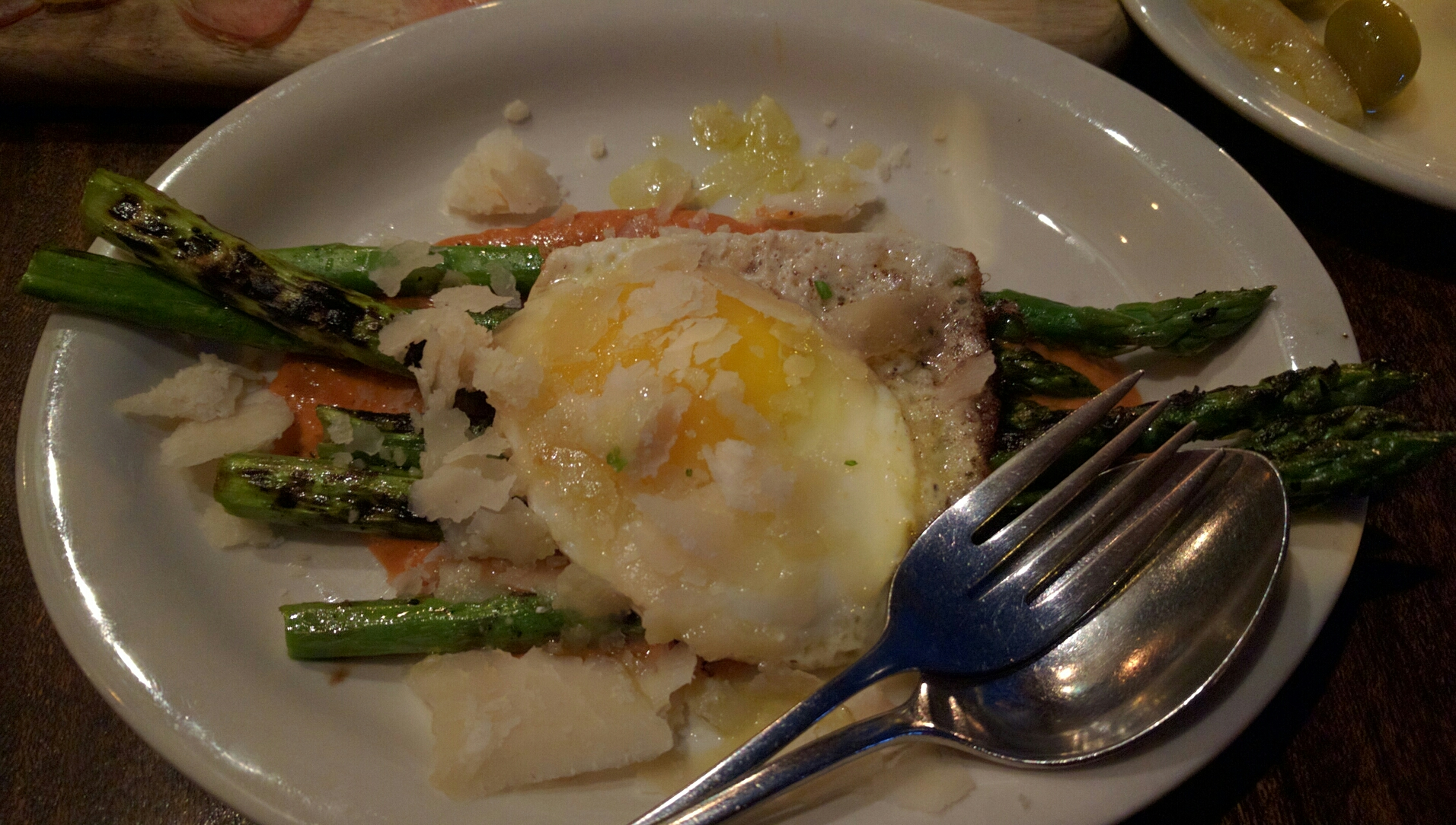 The roasted asparagus are divine, accompanied by manchengo, a tomato cream sauce, and topped with a fried egg.