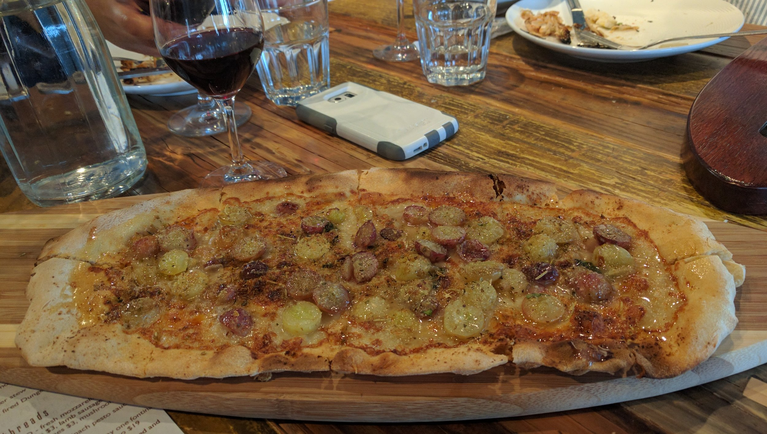 Wine lovers flatbread - gorgonzola and roasted grapes.