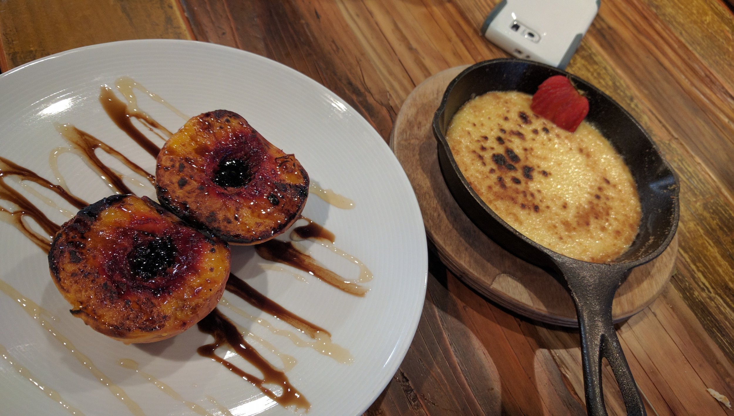 Wood fired peaches with honey and balsamic glaze paired with a cast iron creme broulee.