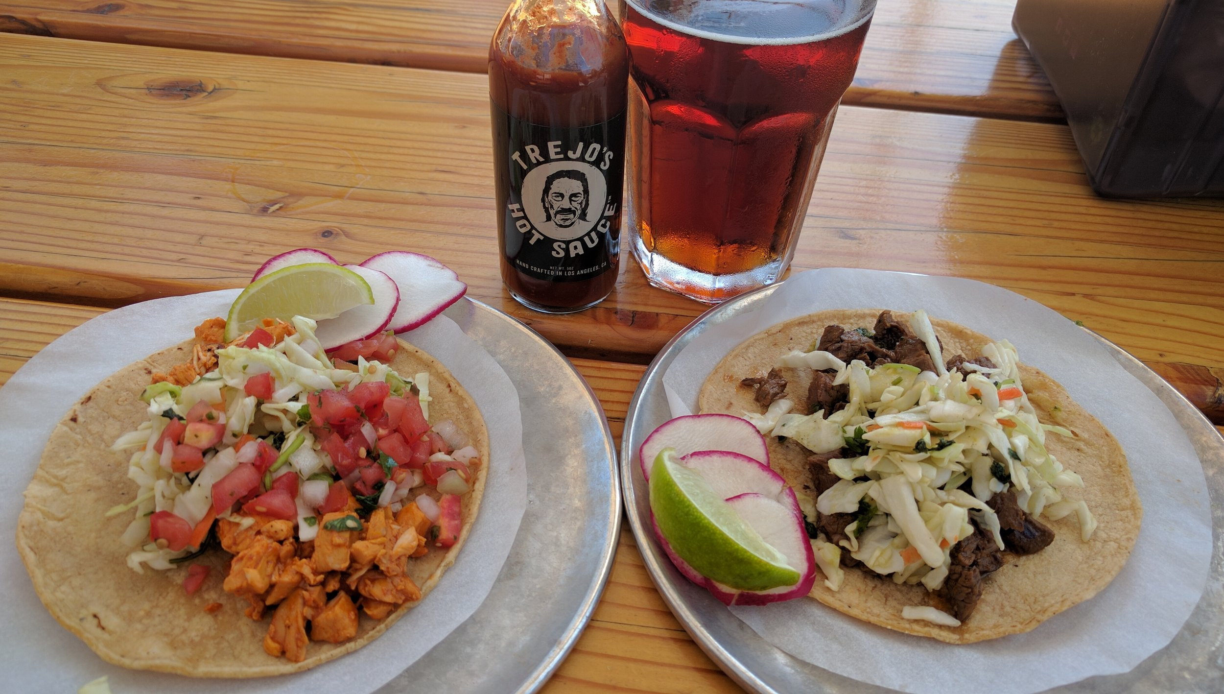 Jidori chicken and steak asado tacos before the application of the Trejo's hot sauce