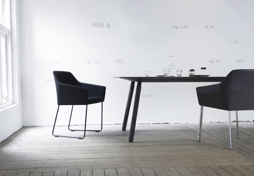 The Nomad Table with the Sketch Chair. Nomad is a lightweight table made entirely of wood, with wood threads so the legs can simply be screwed into and unscrewed from the top.