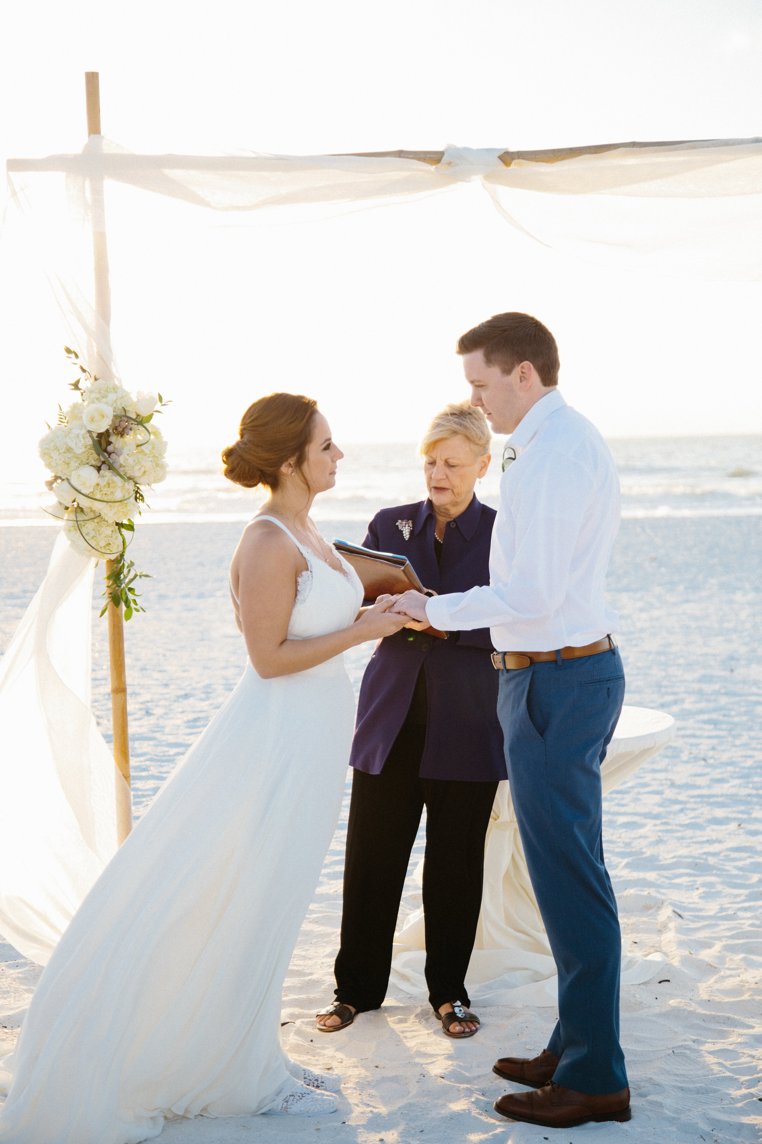 Beautiful, sunny, and intimate Florida beach wedding at Sunset. Documentary Wedding photographer for the genuine couple in love.