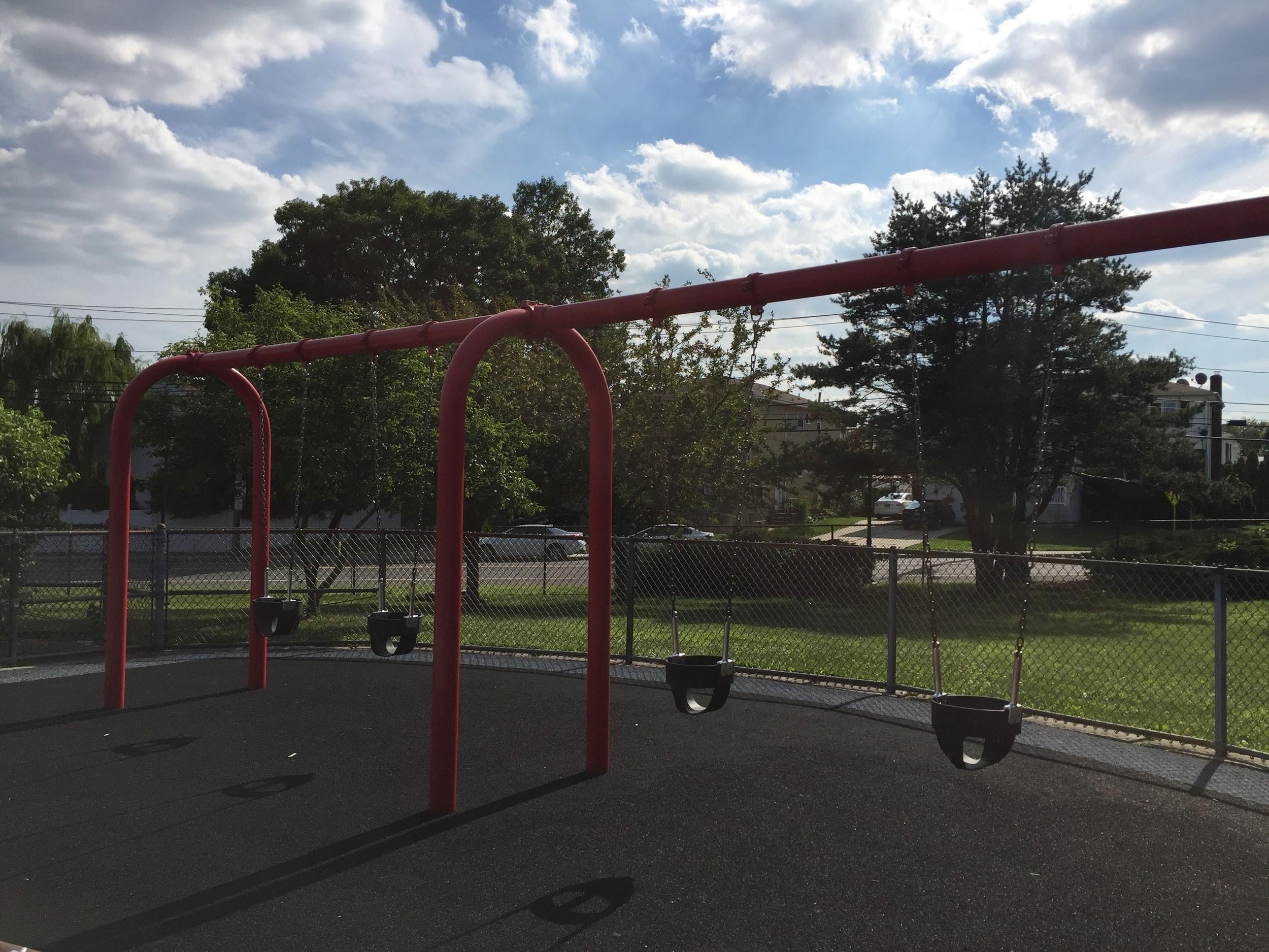 Swings at Senator Speno Park Playground