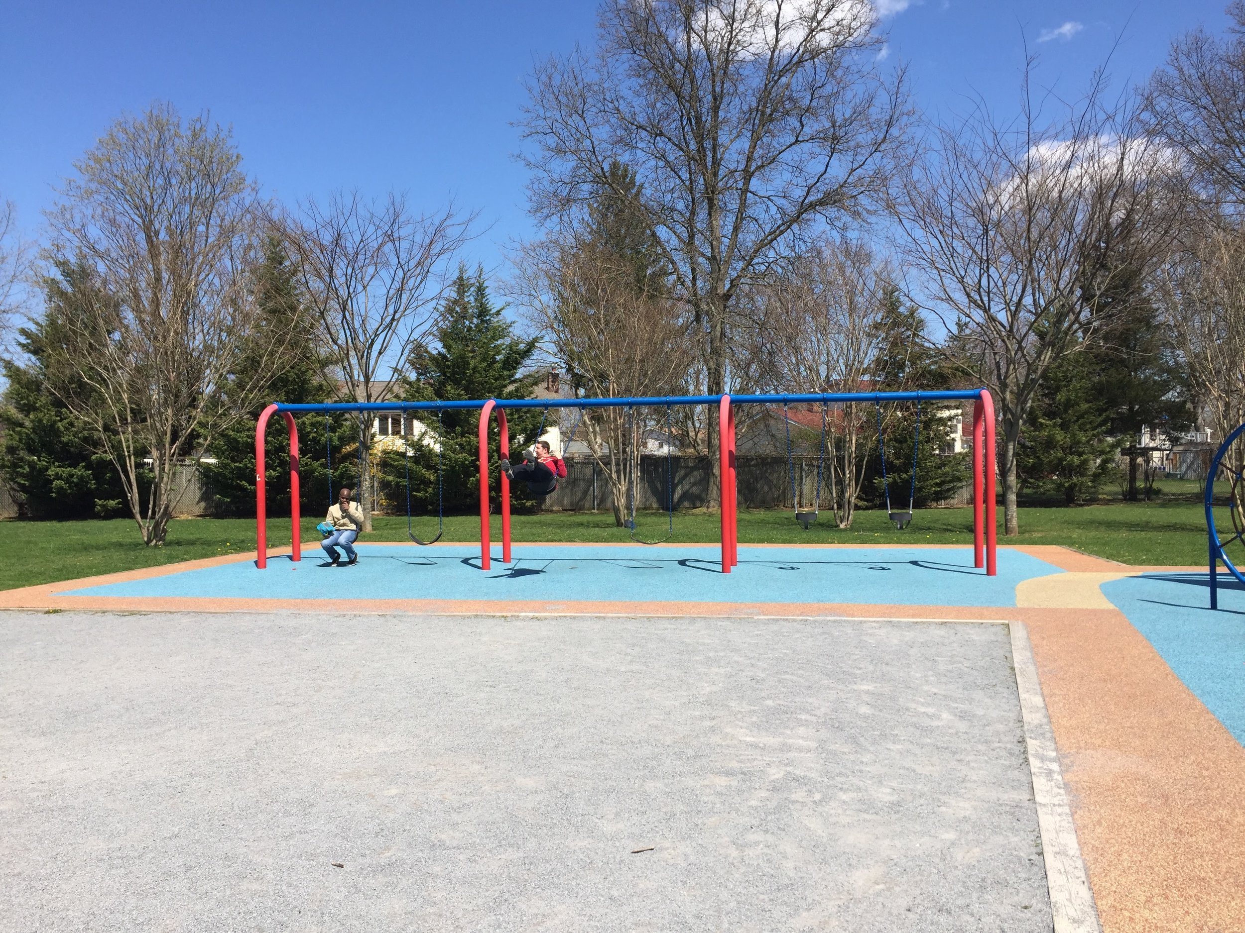 Swings at Colonial Springs Park Playground
