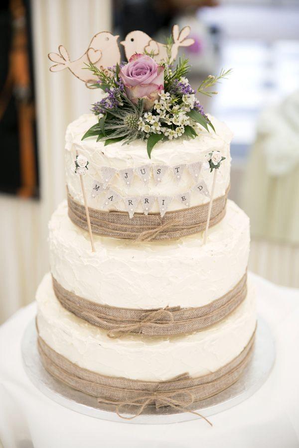 Burlap-wedding-cake-with-wood-lovebirds-topper.jpg
