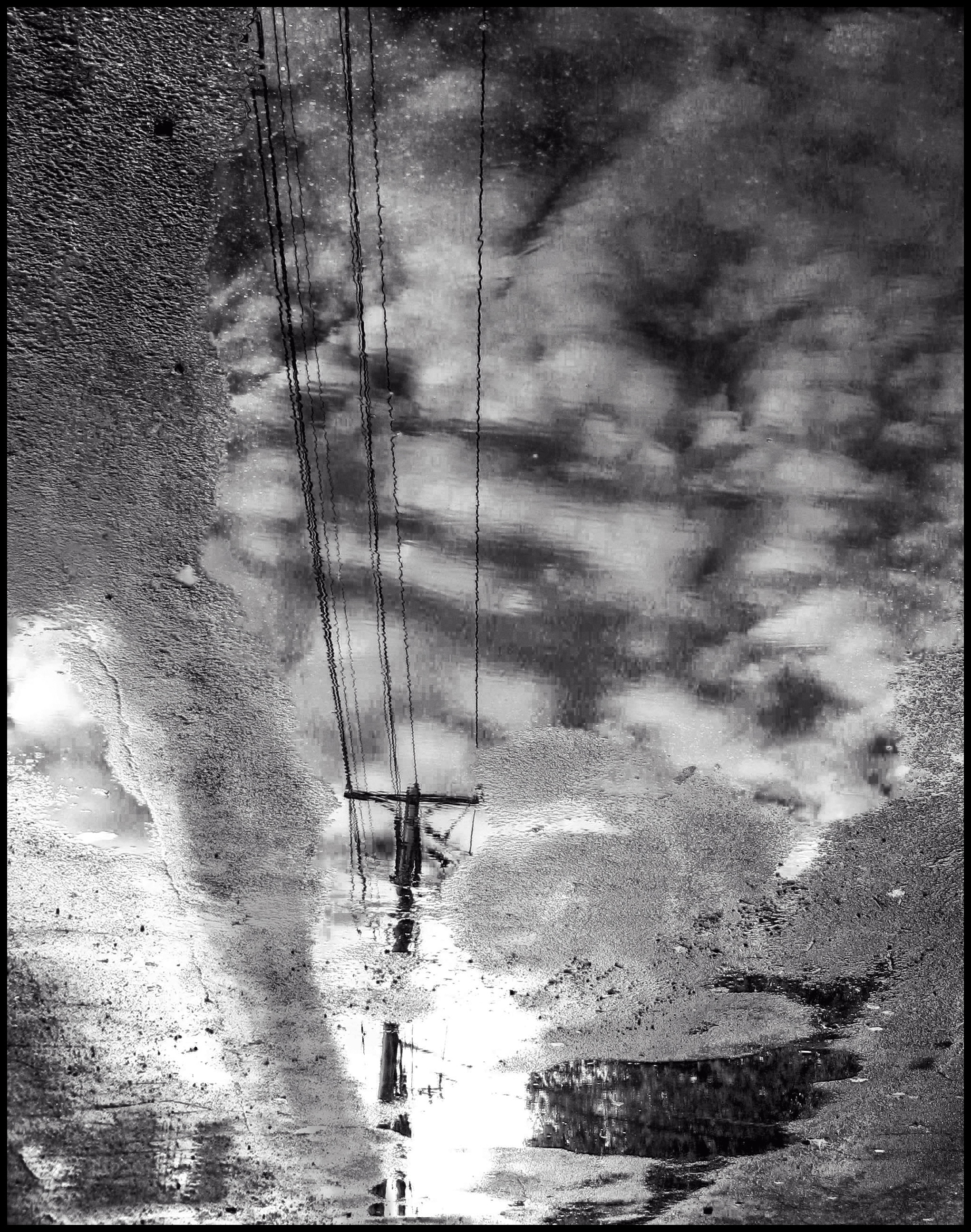 Telephone Pole Reflected In Puddle_edited-1.jpg