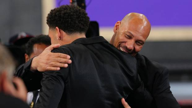 Lonzo Ball celebrates with his father LaVar Ball after being introduced as the number two overall pick to the Los Angeles Lakers in the first round of the 2017 NBA Draft at Barclays Center. (Brad Penner/USA Today Sports)