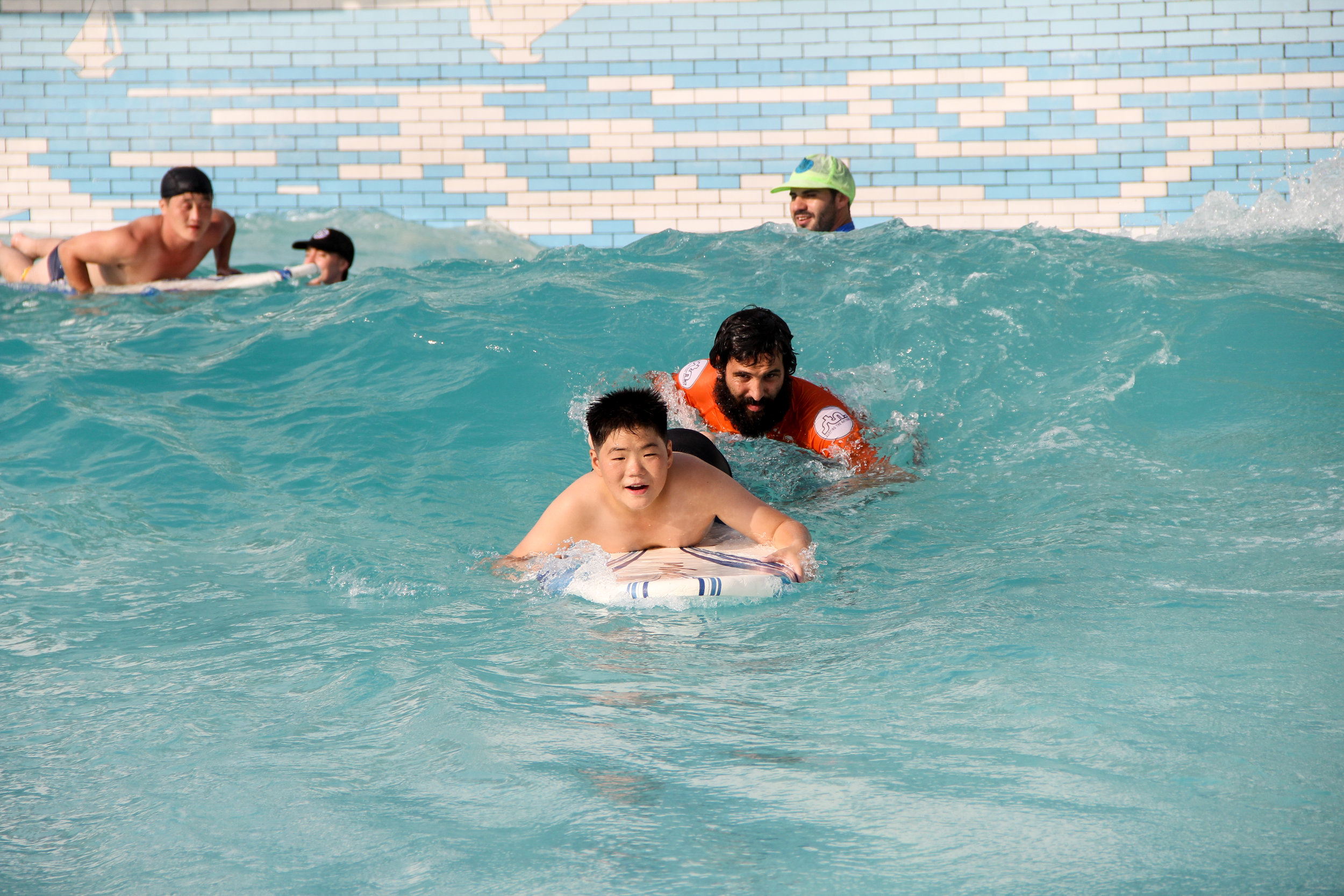 Pyongyang is home to one of the worlds biggest waterparks. It has a small man mad wave pool. We get to share surfing with literally hundreds of locals each year.