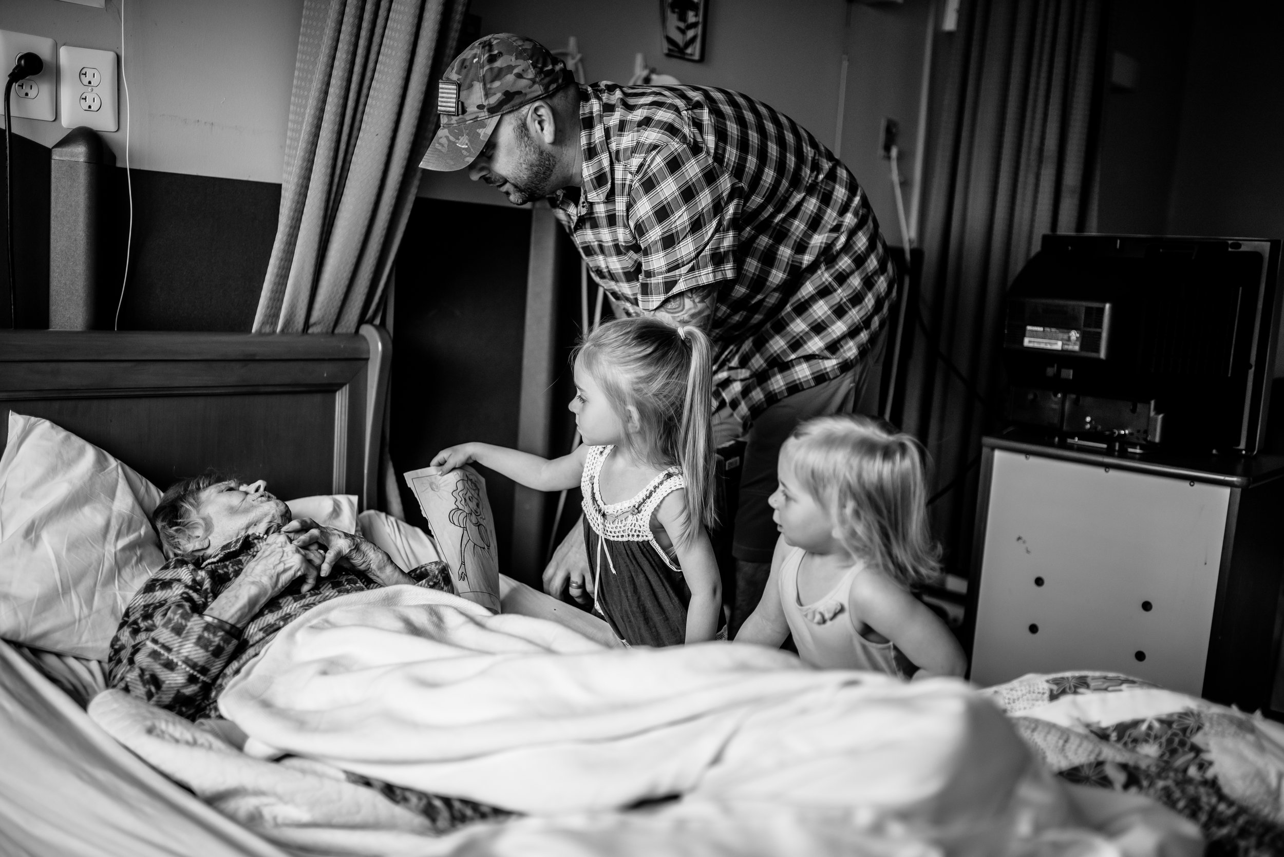 Man and daughters great great-great-grandmother who is in bed