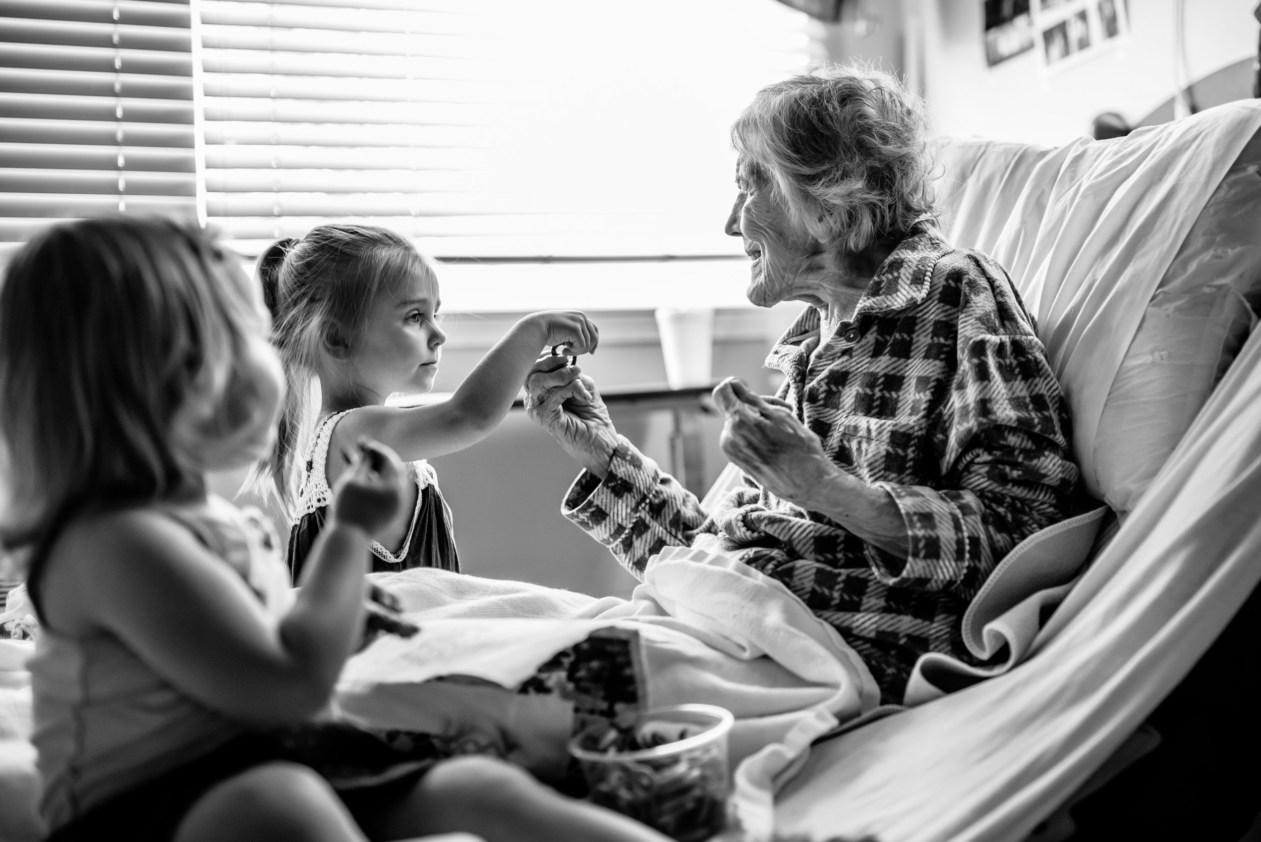 Girls share Glutton pretzels with great-great-grandmother