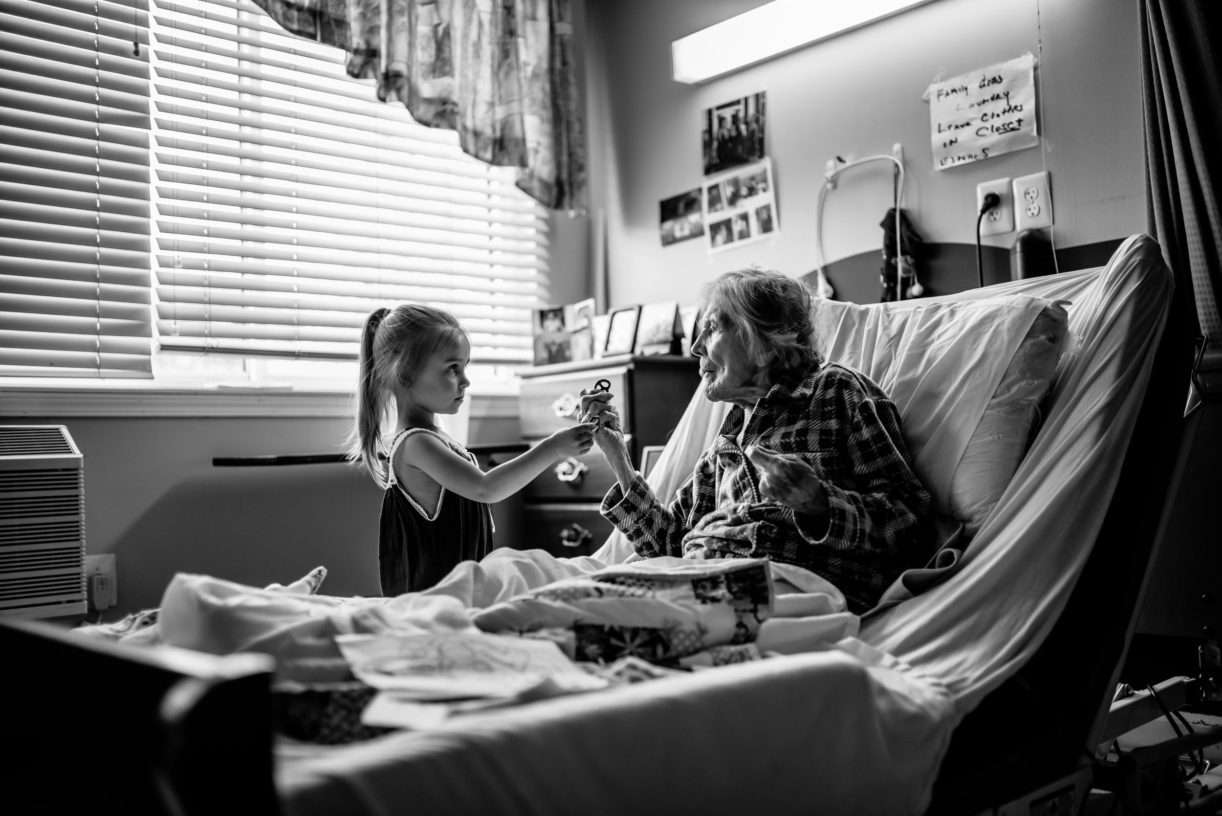 Girl shares Glutino pretzel with great-great-grandmother