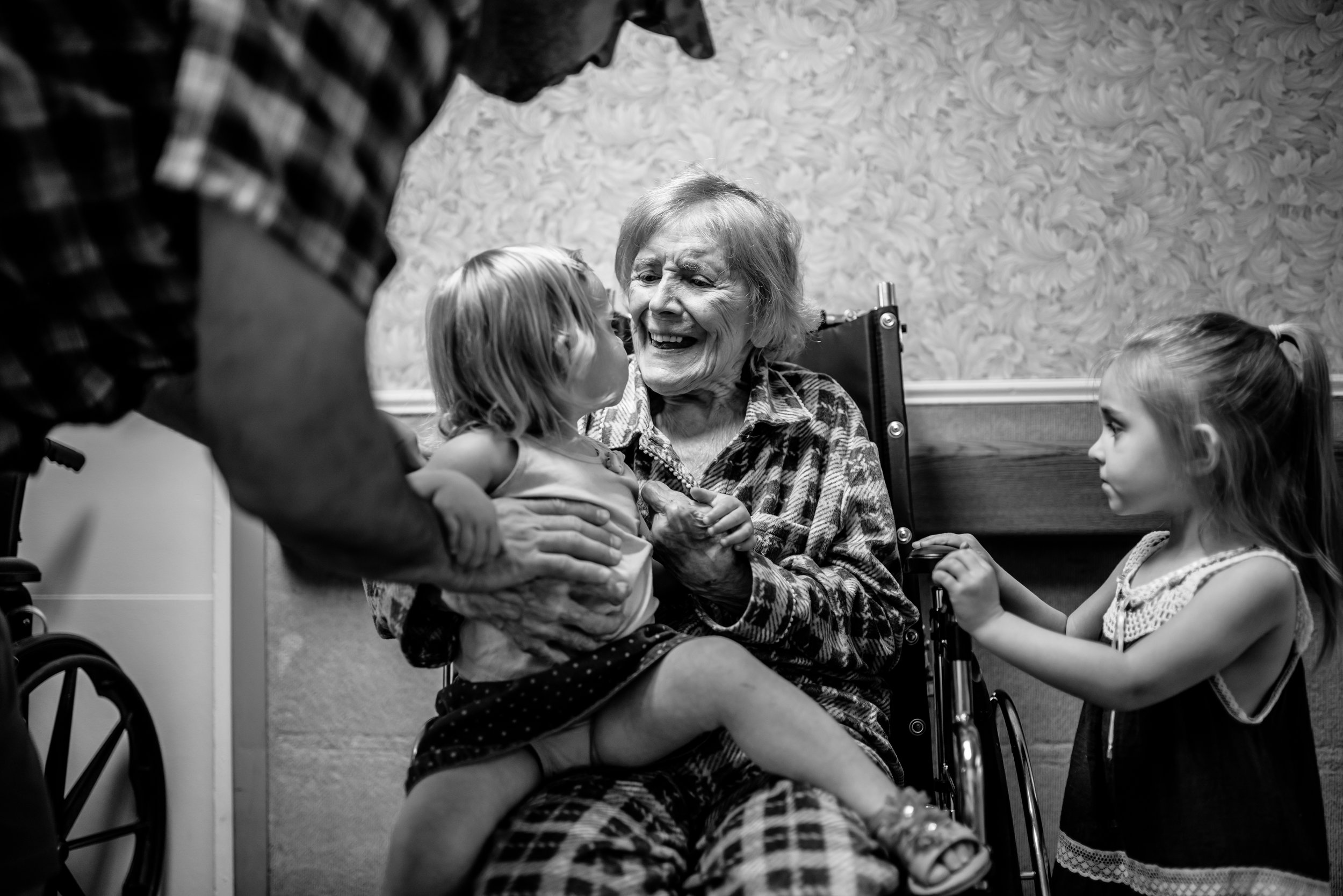 girl sits on great-great-grandmother's lap