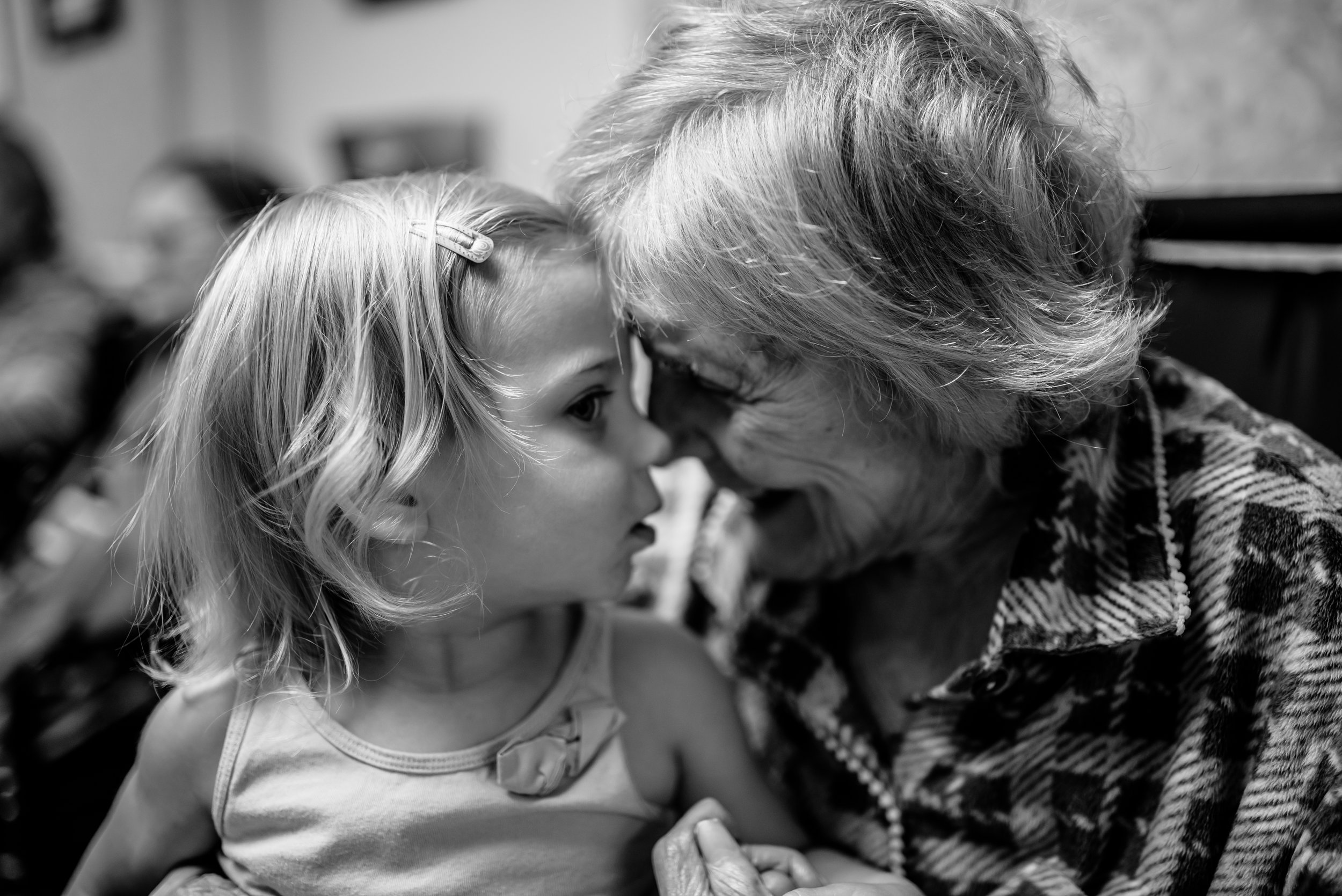 girl and great-great-grandmother look at each other