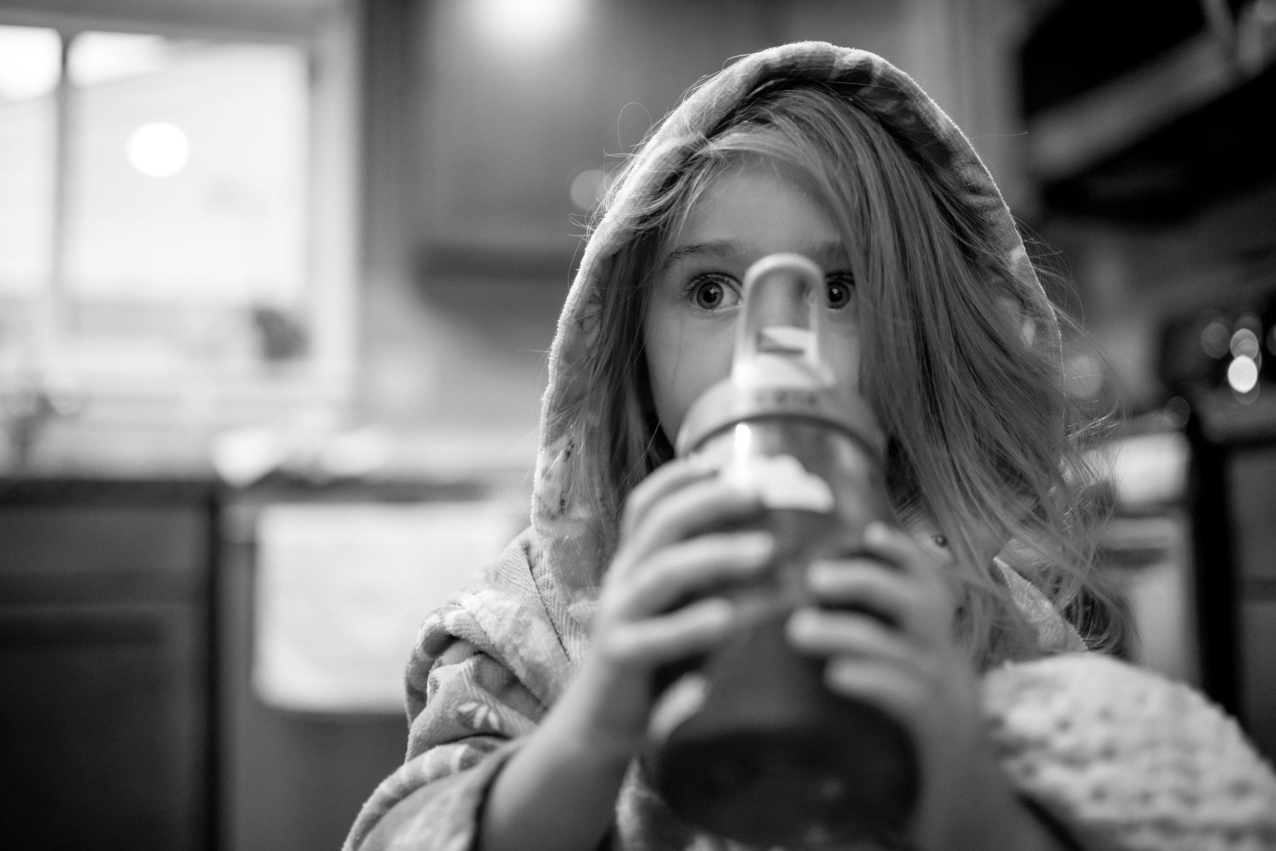 Girl drinks apple juice before heart procedure